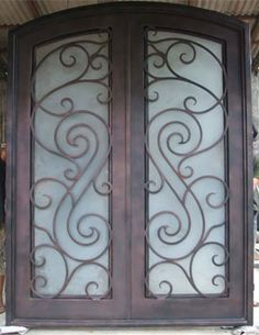 Wrought iron doors with opaque glass
