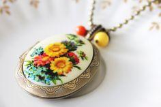 Pretty Pretty. Rare 70s Vintage Locket Bronze Necklace. $45.50, via Etsy.