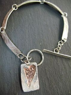Silver bracelet with silver and copper charm made by Shirley on a  day class in Sherwood Forest, Nottingham with Clare Hawley Jewellery.
