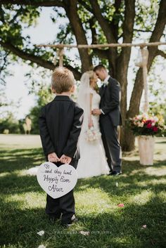 Wedding wedding photography bride and groom cute ring bearer holding sign romantic best of 2016 part one wedding engagement photography the carrs photography weddings portraits weddingphotography le temps des pommes Wedding Picture Poses, Wedding Photography Poses, Wedding Poses, Wedding Photoshoot, Wedding Tips, Wedding Portraits, Wedding Pictures, Wedding Engagement, Wedding Ceremony
