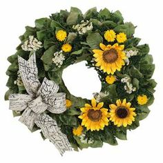 """Preserved wreath with sunflowers and a script-print ribbon. Product: Preserved  wreathConstruction Material: Silicone, preserved leaves, natural twigs and ribbonColor: Green and yellowFeatures: Includes faux leaves, German statice, sinuata, strawflower and sunflowers Ribbon accentHandmadeDimensions: 22"""" Diameter x 4"""" D Cleaning and Care: Wipe gently with a dry cloth"""