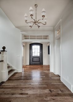 Main Floor Flooring Ideas. Hardwood Flooring Ideas. The hardwood flooring in the main floor is hickory. #MaindFloorFlooring #HickoryHardwoodFloors #HardwoodFloors Veranda Estate Homes & Interiors