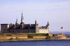 Helsingor, Denmark. Hamlet's castle, and Danish national flag.