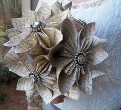 Origami bouquet tutorial.   This would be great using pages from old books, sheet music, scrapbook paper, old maps old magazines....