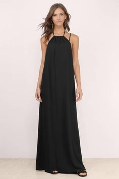 Designed by Tobi. The Soulmate Stripe Maxi Dress features a halter neckline and cross straps at the back. Relaxed silhouette for a chic look.