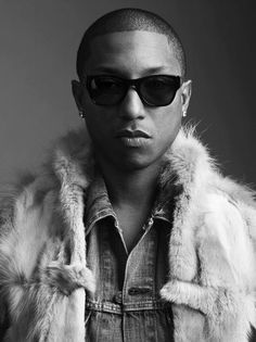 Pharrell Williams. Besides the fact that he is a genius...he is also incredibly well dressed. Hats off to you, Pharrell.