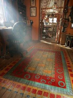 This is so me!  The bead curtain, the hardwood floor, the painted on rug and the light