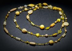 Yellow Allsorts is a necklace that was strung for a bit of relaxation. Very long opera length, can be wrapped three times around the neck. Glass, wooden and acrylic beads.