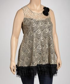 A perfect pick for a modern maven, this top is totally on trend. Allover lace combines with an attached underlay that flows into a ruffled hem. Two large rosettes on the shoulder add a touch of chic to the day's ensemble.