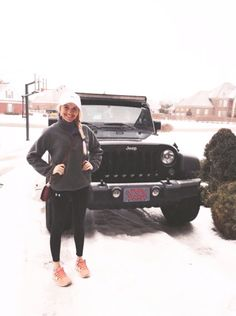 Love her sporty yet preppy style. Super cute, plus the snow makes it even better.
