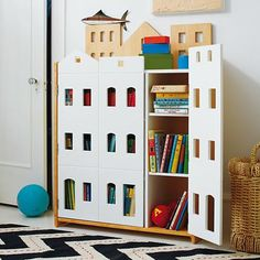 Spruce up your child's storage cube shelves by putting on themed doors.