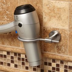 She will love this hair dryer holder mounted in the bathroom.   Bristow Collection Hair Dryer Holder  http://www.signaturehardware.com/product20806#