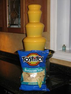 I find this pretty awesome!    A Nacho Cheese Fountian!!!  You'd never get me away from it!!!