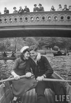 A sailor and his date on a boat ride in Central Park, while he's on shore leave in 1943