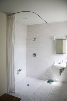 a little laboratory-like, but i like the minimalistic look. I probably would have gone with a glass divider between sink and shower, but i like the hint of separation with the step down into shower. cool.