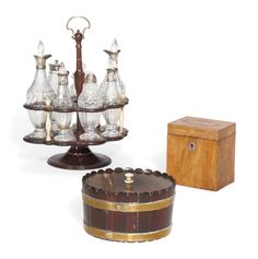 A GEORGE III MAHOGANY AND SILVER MOUNTED GLASS CRUET SET | CIRCA 1792 | cruets, All other categories of objects | Christie's Brass Band, Silver Tops, Tea Caddy, Tortoise Shell, Cut Glass, Glass Bottles, Objects, Silver Strappy Tops, Drink Cart