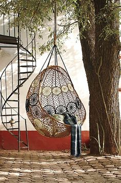Anthropologie Out door Swing Chair. Would love one of these!