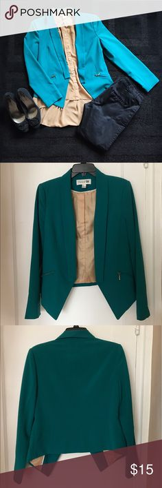 Real Structured Blazer Statement blazer in beautiful Teal color with gold lining and white interior piping. Each side comes to a point at the front, making this piece more unique. Blazer has faux pockets at the front. Zippers are functional, and have slight wear. Forever 21 Jackets & Coats Blazers