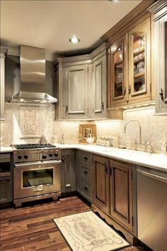 gray stained cabinets~ I have a hard time painting wood so maybe stain them gray so grain is still visible?