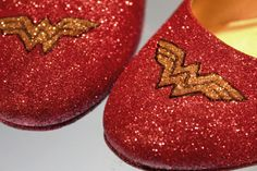 """These glittering Wonder Woman inspired shoes are my new favorite thing. It's simple, inexpensive and you can complete them in one afternoon. Just watch out for one thing: my brother claims my house looked like there had been a """"glitter apocolypse"""" after I finished them!"""