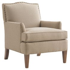 Add a touch of refinement to your library or bring classic appeal to your living room seating group with this lovely arm chair, featuring tan houndstooth-pri...