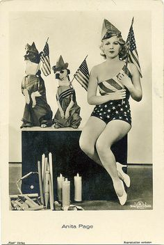 vintage pic of woman and dogs with flags