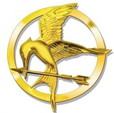 Mockingjay Pin! I just finished the first book and of course now I MUST HAVE THIS PIN! :-D