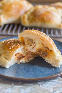 Homemade Calzones - Warm, soft pockets of pizza dough stuffed with Italian sausage, marinara, and mozzarella cheese.