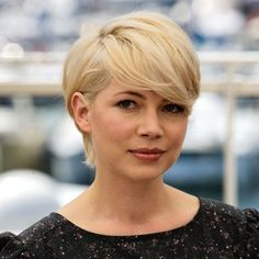 I like this longer, softer short hair style. . . the straight-up pixie/gamine can be pretty harsh if you're features aren't perfectly suited.