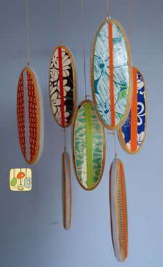 Baby Mobile Surfboards - Reclaimed Wood and Designer Prints - Beach Themed Nursery. $75.00, via Etsy.