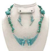 Turquoise Pistol & Wing Necklace Set from Ropes & Rhinestones http://www.ropesandrhinestones.com/tupiwineset.html