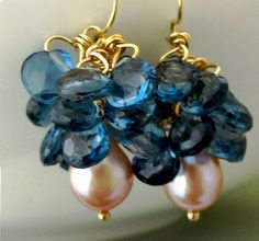 Hey, I found this really awesome Etsy listing at https://www.etsy.com/listing/235873088/18k-london-blue-topaz-and-pearl-cluster