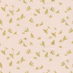 Peach and Gold Birds Fabric by the Yard | Carousel Designs.  These sweet birds in flight feature a stunning gold metallic on an peachy-pink background. Printed on a soft 100% cotton its sure to become one of your favorite bedding items.