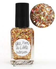 Lynnderella Limited Edition—Yes, I'm a Little Warm is a blend of gold, bronze, orange and tan metallic glitters with subtle gold holographic and blue iridescent accents—all in a gold-shimmered base.