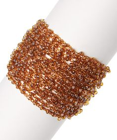 Look at this #zulilyfind! Brown Beaded Mesh Bracelet #zulilyfinds #‎jewelry‬ ‪#‎turquoise‬ ‪#‎turquoisejewelry‬ ‪#‎jewelrysale‬ ‪#‎giftidea‬ ‪#‎bracelet‬ ‪#‎necklace‬ ‪#‎earrings‬ ‪#‎sale‬ ‪#‎gift‬ ‪#‎fashion‬ ‪#‎fashionjewelry‬ ‪#‎pavcusdesigns