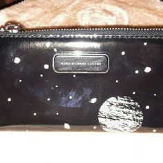 Marc hy Marc Jacobs galaxy wallet Beautiful Marc Jacobs black leather wallet with galaxy design on outside. Ziparound. Inside has multiple. Card slots, pockets inbetween. Used for short time, just got new wallets so I'm selling a few Marc by Marc Jacobs Bags Wallets