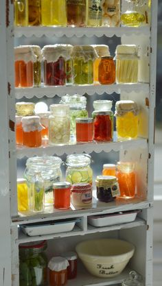 Cottage design: easy to make cabinet,  Google how to diy canned/pickled goods.