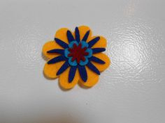 6 striking large felt flower magnets- felt crafts- yellow, navy blue, teal and burgundy center. by grandmotherskisses on Etsy https://www.etsy.com/listing/99680580/6-striking-large-felt-flower-magnets
