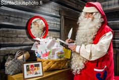 Santa Claus reading letters from children in Santa Claus Holiday Village