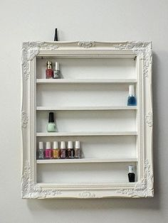 picture frame with small shelves for essential oils