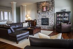Crate and Barrel, Stone fireplace, Tiger wood floors, leather sectional