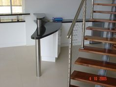 Curved granite bar & upstand, with stainless steel posts