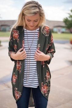 Floral olive printed cuffed cardigan. A best selling cardigan is now available in a print that is absolutely to die for! We promise these won't last! Great layered over a striped Piko top or striped P