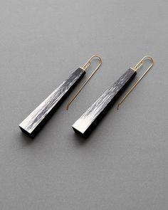 """Julia Turner """"White Shift"""" earrings, 2015. Walnut, gesso, 18k gold. 2 x 1/2 x 1/4 in (5 x 1 x .7 cm)."""