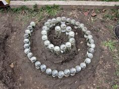 spiral herb garden using recycled bottles