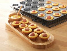 Corn Dog Bites:  Mix up an 8.5oz box of corn muffin mix, divide batter into the Mini-Muffin Pan, and add hot dog slices. Bake for 10-12 minutes at 375°.