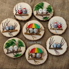Painted rocks on logs (mounted on wood slabs). She has a lot of really cute painted rocks.