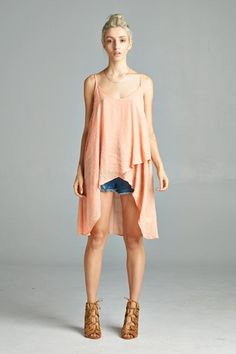 T14568 Loose fit, spaghetti strap, round neck hi-low tank. Front overlaps. This tank is made with slightly textured crinkled gauze that is lightweight, drapes very well and is soft. Fabric : 60% Rayon, 40% Polyester Made In : U.S.A