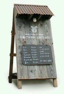 wood and white signage shop