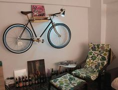 Wooden Bike Rack - Natural  This product is special to us for it serves multiple purposes, beside safely and elegantly storing your bike: it can function as a shelf for flower pots, small aquariums, bicycle tools, decorative objects or tiny things. It can be your small bookshelf, hiding magazines, letters and gifts. It adds a personal and modern touch to your room and, one of its most important features, it saves a lot of space.  The bike rack is easy to mount and use, it is simple and fresh…